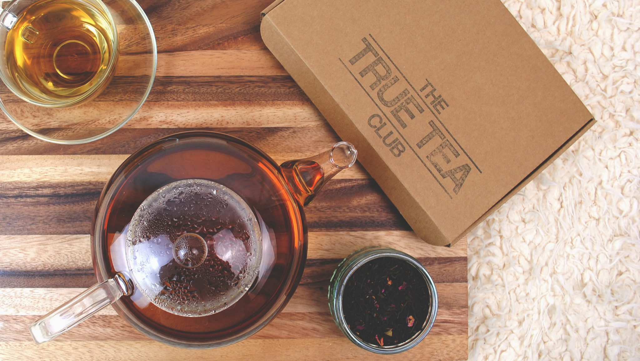 a teapot with cinnamon and rose black tea inside which has been placed next to true tea club's subscription box